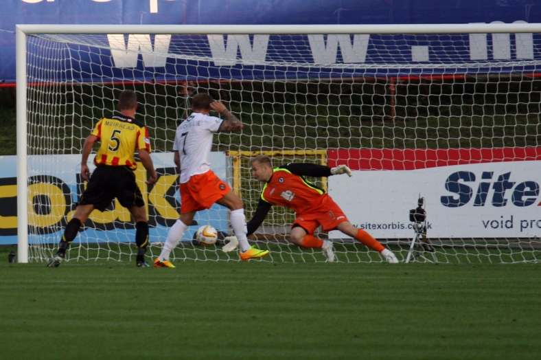 Scott Fox gets low for one of a string of impressive saves.