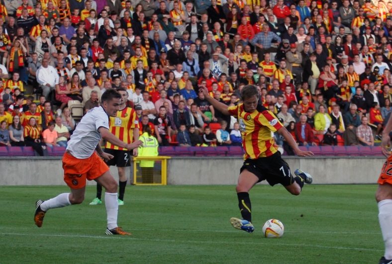 New Thistle no. 7 Gary Fraser shoots from the edge of the United area.