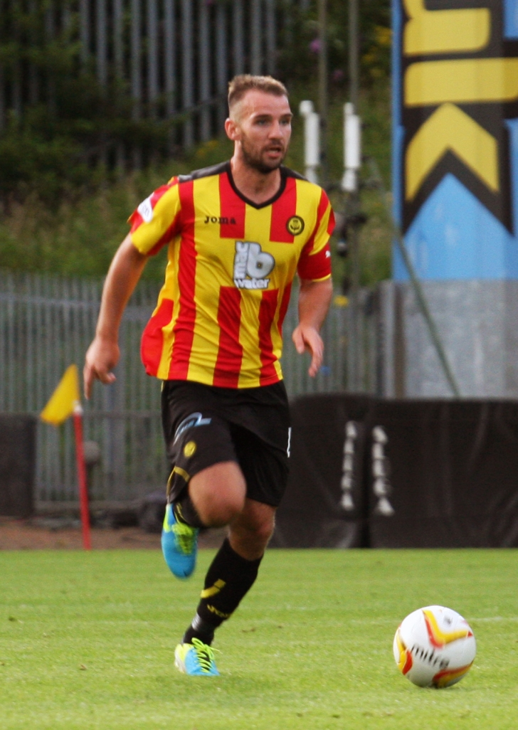 Sean Welsh drives forward with the ball. The Thistle captain proved indefatigable on the night.